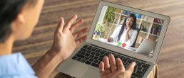 A leadership coach connects with a client via an online video call
